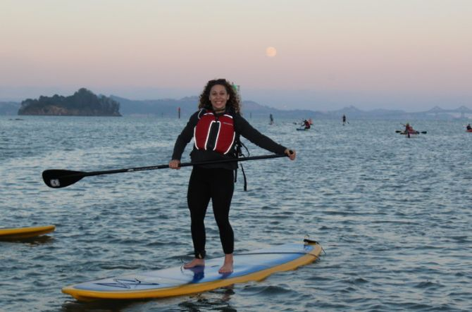 A Stand up paddleboard enjoying our full moon moonlight paddle tour