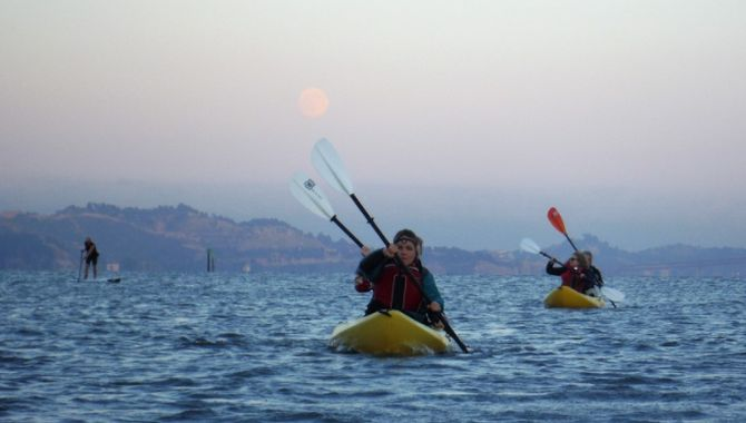 Moon rise by kayak on paddle tour on san francisco bay