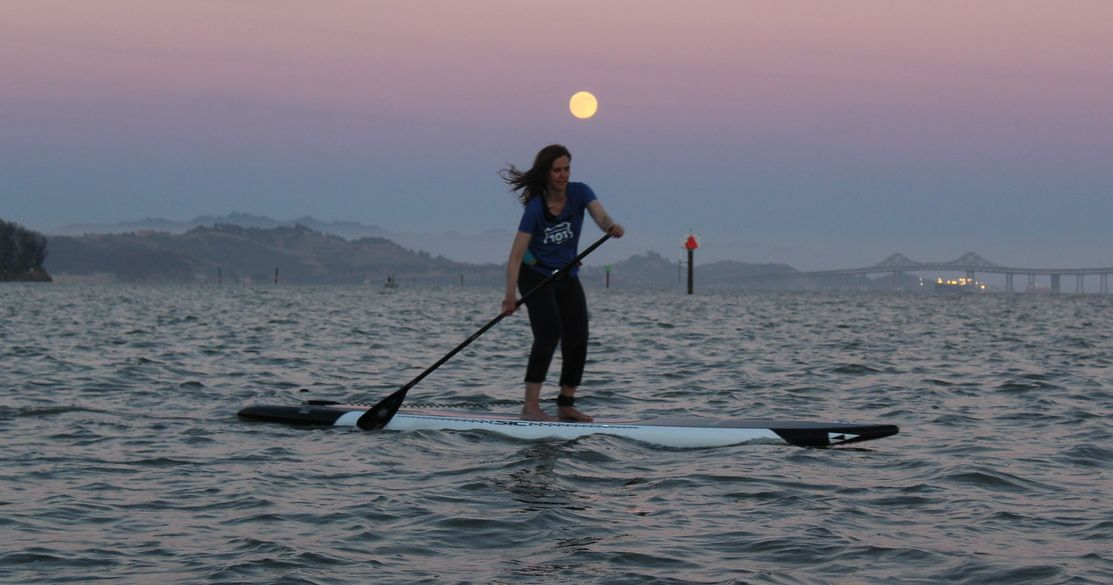 Paddleboarding under the full moon on San Francisco Bay