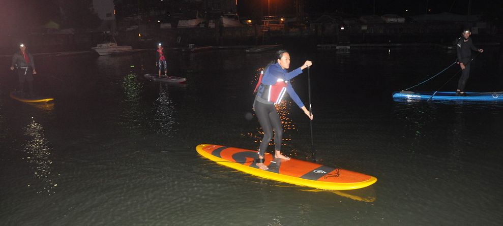 Paddleboarding on a moonless night
